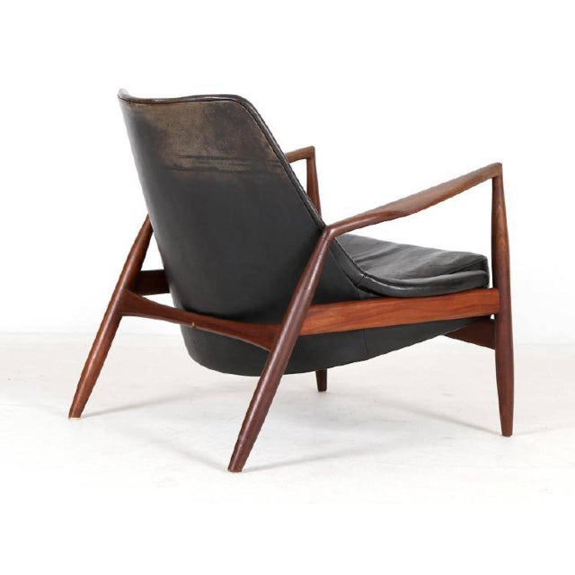 Ib Kofod Larsen, 'Seal' lounge chair model 503-799, in teak and original black leather, for OPE, Sweden, 1956. The chair...