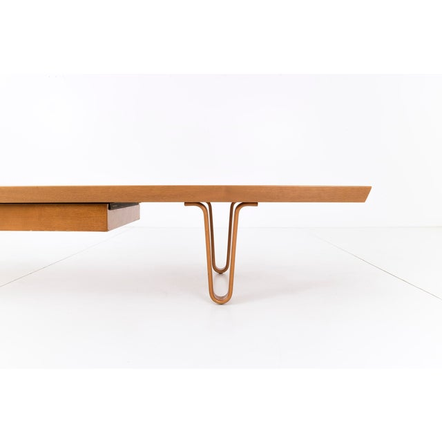 Long John bench or coffee table designed by Edward Wormley for Dunbar. Tongue and groove walnut top with drawer, supported...