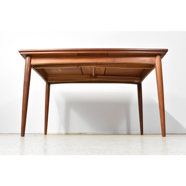 An absolutely stunning, authentic, Mid Century Danish Modern draw leaf teak dining table. Built in the early 1960s by...