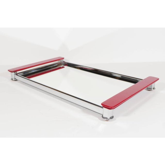 Art Deco serving tray with Machine Age design. The tray has a streamlined polished chrome frame and features a mirrored...