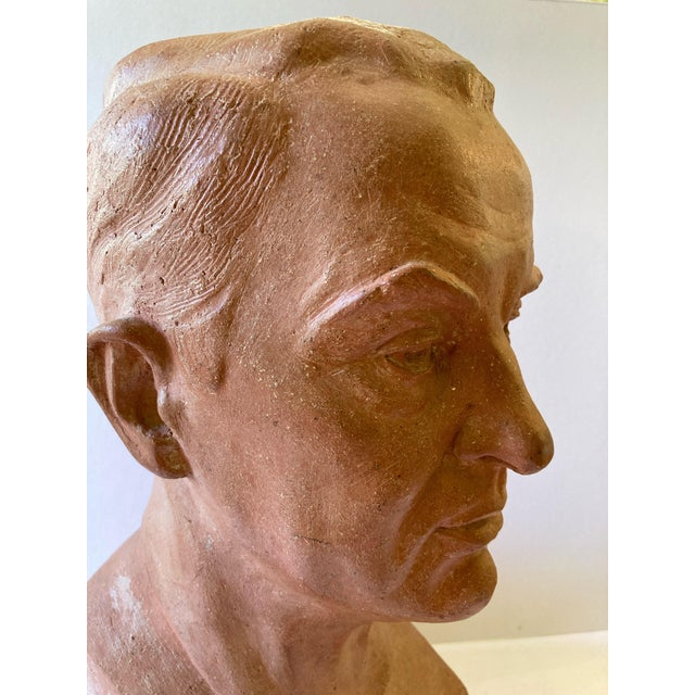 A beautifully rendered, terra cotta bust, signed Lillian Alperson, Dated 1946