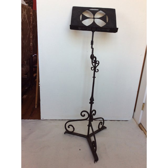 Antique Iron stand with triple scrolled iron base. This is great for music or books, or menus. Hand wrought Iron.