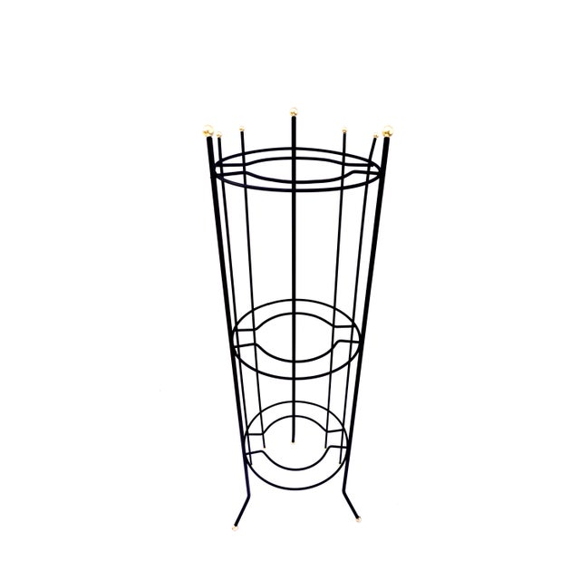 This tall, eye-catching, Mid-Century Modern metal vertical standing plant stand is SO COOL! Featuring an awesome...