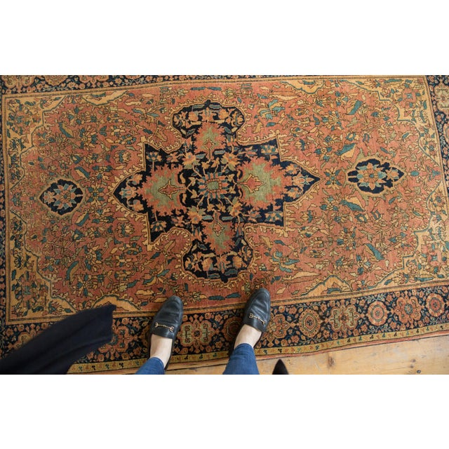 :: Quite a unique antique rug. A Farahan Sarouk Persian rug circa 1890 that not only has an end with its original plain...