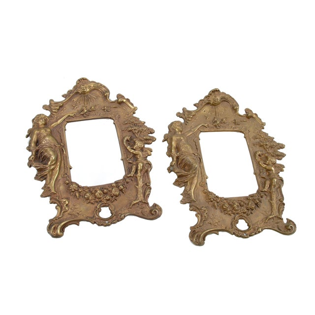 """Pair of 1970s bronze picture frames with angel motifs. Each holds an image up to 3.5""""W x 5""""H. Overall great craftsmanship."""