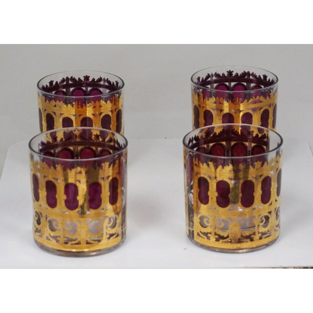 """Set of four cocktail glasses by Culver, in the Hollywood Regency """"Cranberry Scroll"""" pattern. Each features intricate 22k..."""