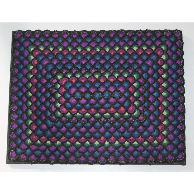 Pennsylvania wool Mennonite geometric rug. Black, purple, blue, pink and white. Rug is mounted on black linen and wood frame.