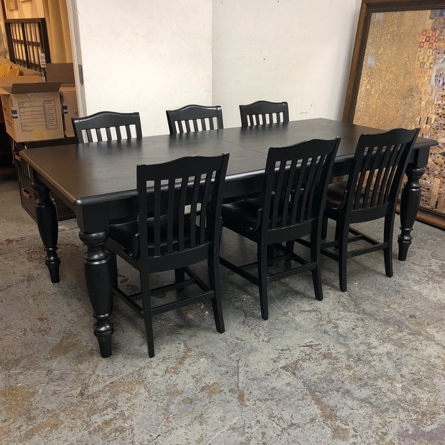 Design Plus Consignment Gallery has a - Pottery Barn - Francisco Black Table + Six Chairs +Leaf Dimensions: W83D40H30....