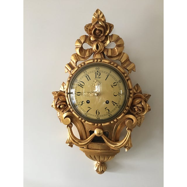 French style carved gold leaf wall clock., with carved roses.