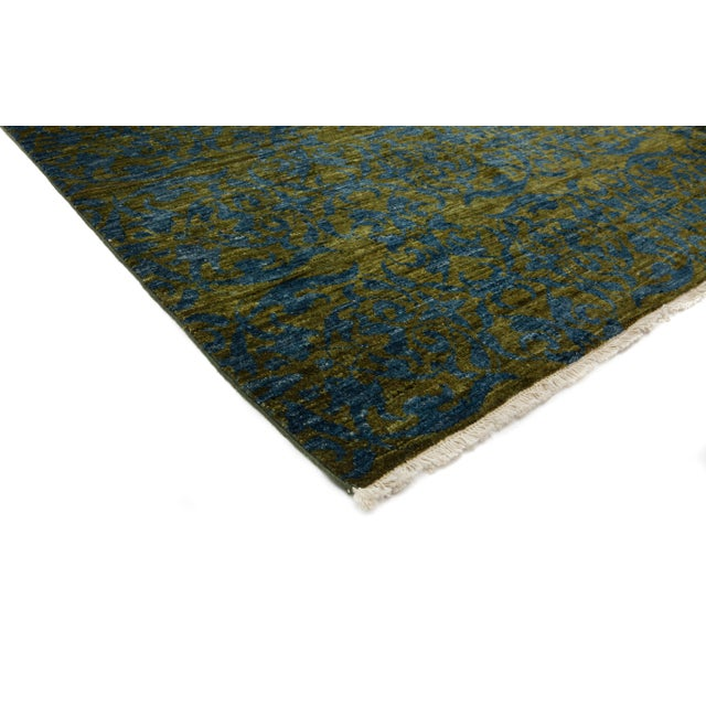 Suzani hand knotted area rug made in Pakistan. Inspired by embroidered Suzani textiles from Uzbekistan, this rug features...