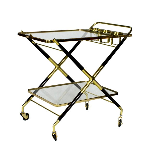 Splendid bar cart, stained beech wood, French polish. Polished brass and glass. Removable tray and bottles containers....