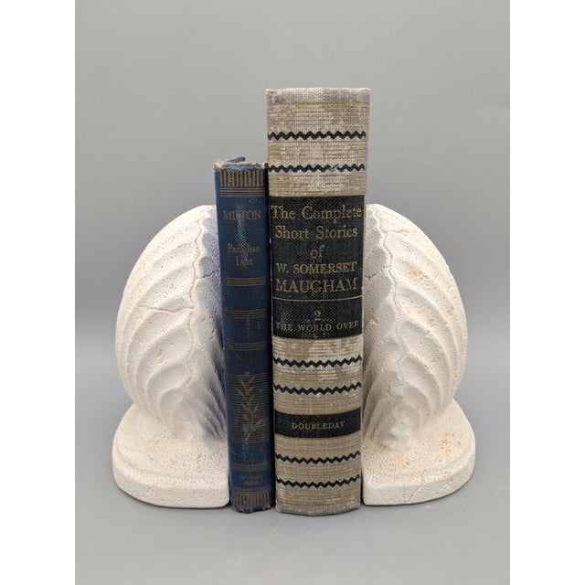 Lovely pair of nautical shell bookends. Designed to look as if they are made of a porous stone. Perfect for beach or cape...