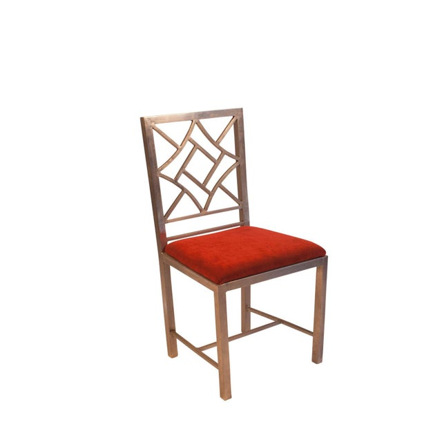 A modern take on a classic design, a steel Chinese Chippendale Style side chair. We have 2 of these chairs available....