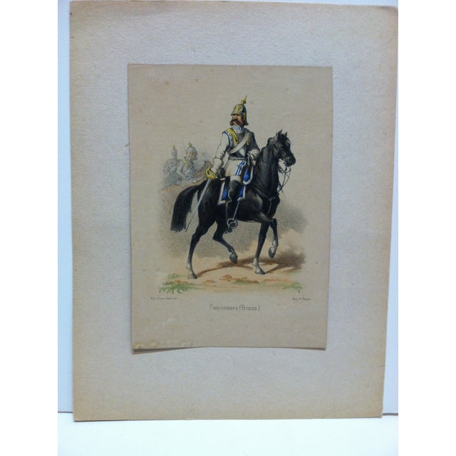 "This is an Original Hand-Colored Print that is titled ""Cuirassiers (Prusse)"" By E. Simon. The Print is dated from around..."