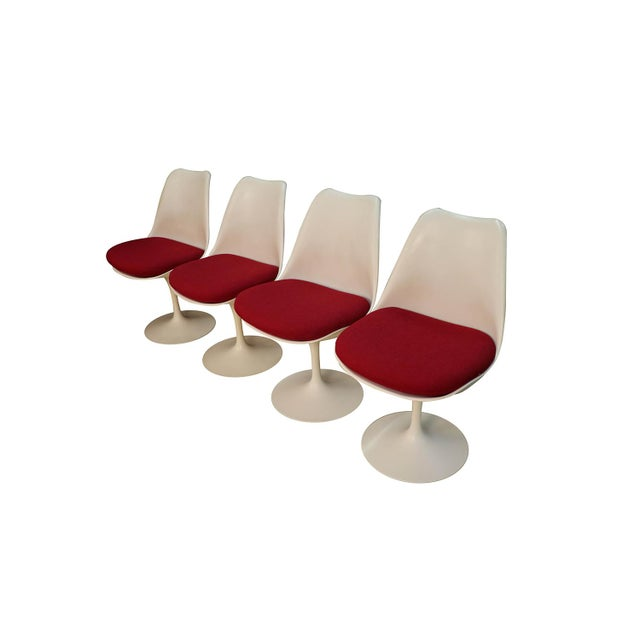 Classic mid-century modern set of four armless tulip swivel, side, dining chairs, for Knoll designed by Eero Saarinen (USA...