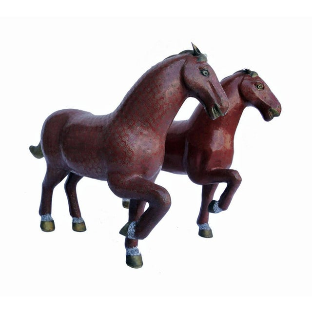This is a pair of bronze horses in red, gold and white color. Traditional Chinese cloud pattern was painted on their body....
