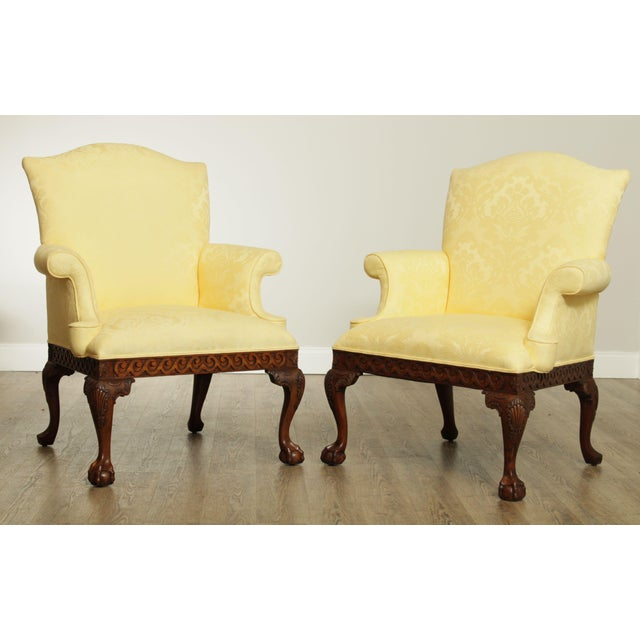 High quality custom upholstered pair of carved mahogany frame armchairs by Ardsley Hall. Store Item#: 26650