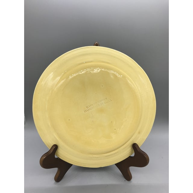 This pottery plate is made in Kona and gives you a real taste of Hawaii. Gorgeously Decorated with hibiscus and dancing...