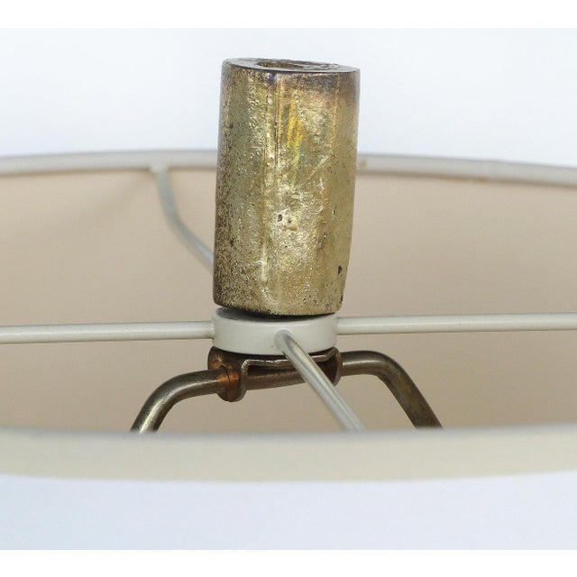 Silver Leaf and Giltwood Table Lamp Offered for sale is a silver and gilt wooden table lamp. The lamp accommodates a...