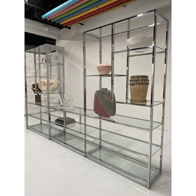 This vintage Milo Baughman style chrome etagere is in excellent shape and features an elegant arrangement of shelves of...