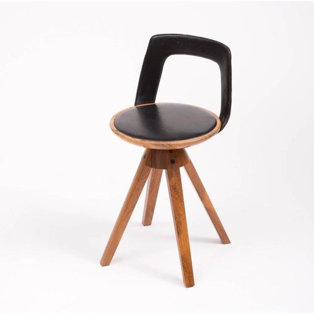 A swivel stool in rosewood and original black leather designed by Tove and Edvard Kindt-Larsen for Thorald Madsens...