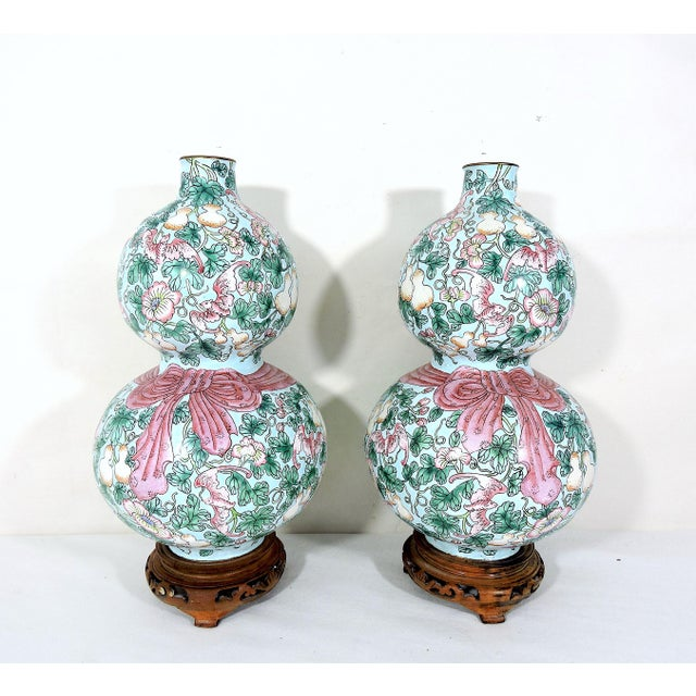A rare pair of delightful pastel pink, green, and turquoise/pale blue double gourd enamel vases with a pretty pink (bow)...