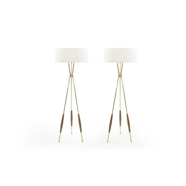 Extremely hard to find matching set of brass and walnut tripod floor lamps designed by Gerald Thurston for Lightolier,...