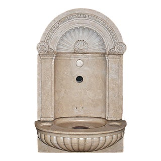 Early 20th Century Carved Soft Tan Pink Marble Wall Fountain For Sale