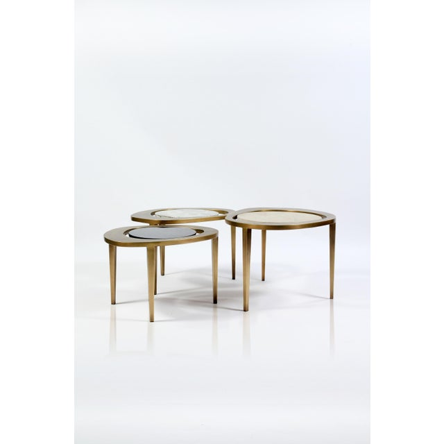 The peacock nesting coffee table large is an iconic R&Y Augousti piece and one of their first designs. The piece both...