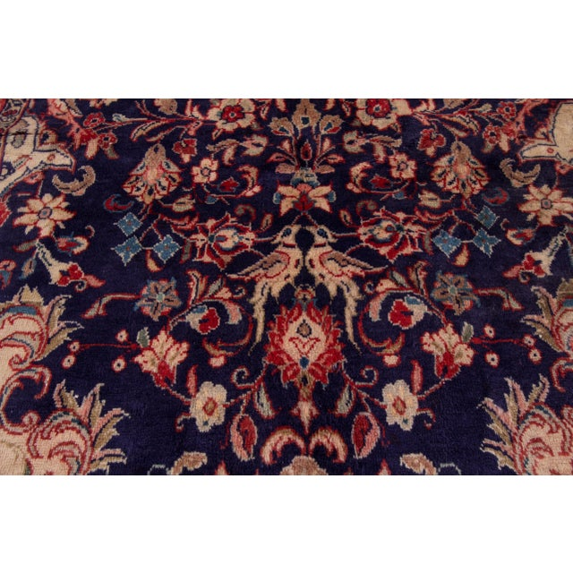 A hand-knotted vintage Hamadan rug with a medallion floral design. This piece has great detailing and colors. It would be...
