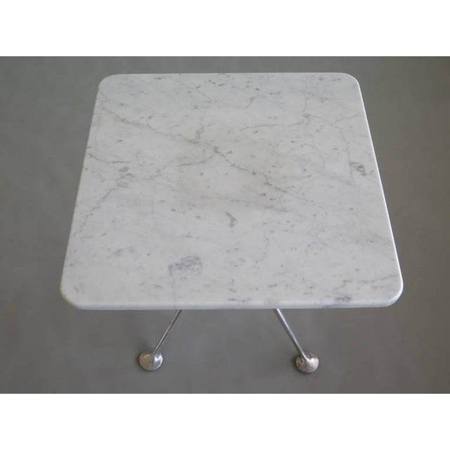 This is a rare marble top table by Alexander Girard for Herman Miller. The piece is from the 1960s.