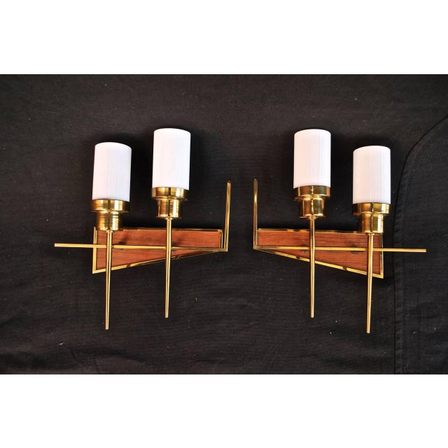 We have over three thousand antique sconces and over one thousand antique lights, if you need a specific pair of sconces...