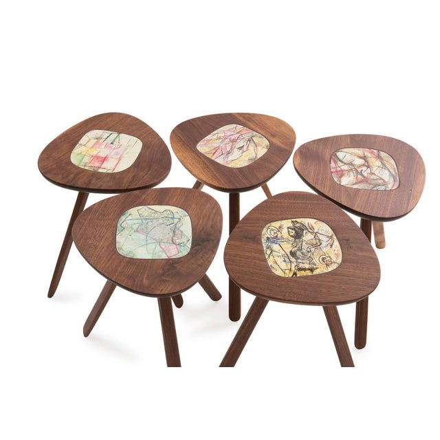Four Lee Porzio and Allen Ditson walnut and ceramic side or occasional tables. These magnificent examples were recently...