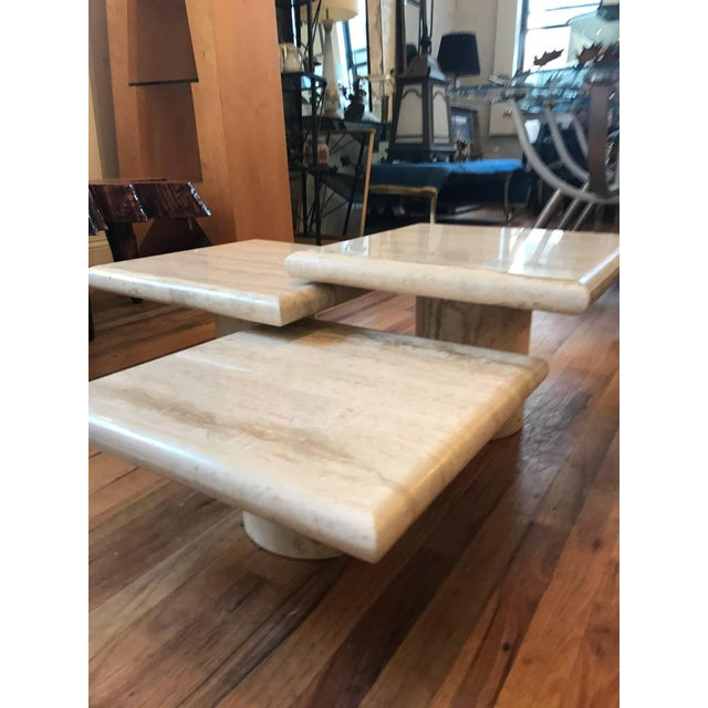 A set of three richly veined Italian Travertine pedestal coffee tables. A highly versatile trio which can be arranged in...