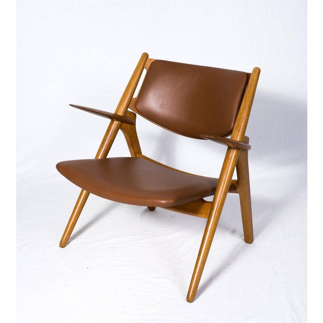 Hans Wegner CH-28 lounge chair designed in 1951 and produced by Carl Hansen & Søn. Store formerly known as ARTFUL DODGER INC
