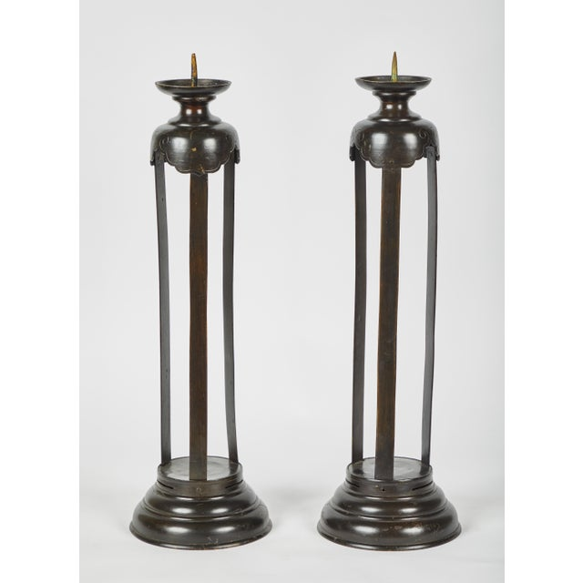 Tall, open column Edo Period Japanese pair of bronze candlesticks. Etched detail near tops.