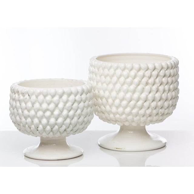 This uniquely textured planter will fit in just about anywhere. A traditional white ceramic footed planter that will add a...