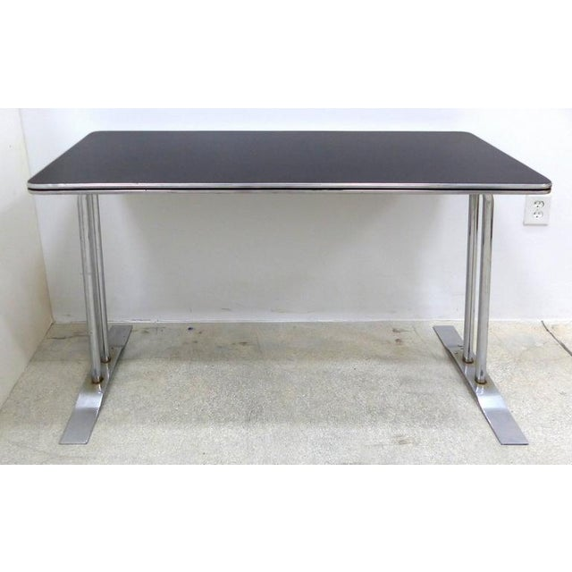 A streamline Art Deco writing desk in chrome that can be used as a console table. A very sleek example of iconic Art Deco...