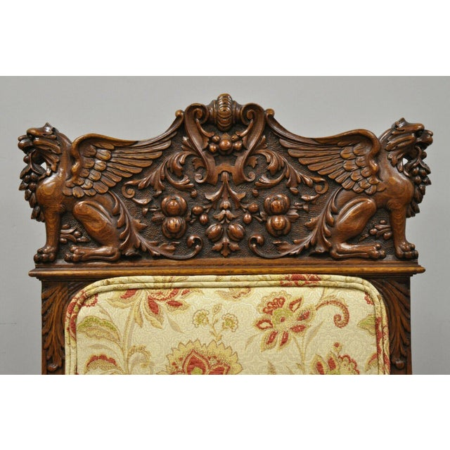 Pair 19th C. Carved Oak Winged Griffin Paw Foot Dining Side Chairs Attr. RJ Horner. Listing includes carved winged griffin...