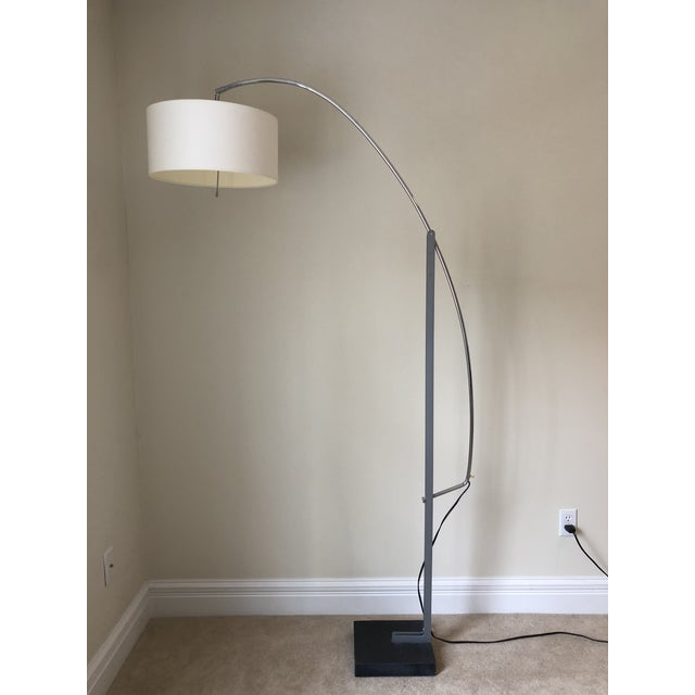 Design by Thibault Desombre, made in France. Adjustable arc floor lamp with counterbalance controlled arm. Structure in...