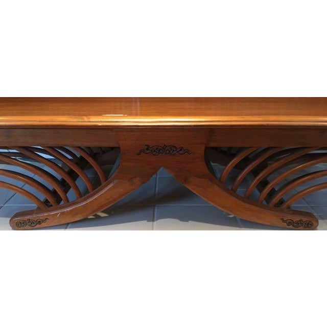Hand carved teak daybed or settee in the style of a Thai elephant seat (howdah). This bed has decorative carved panels in...