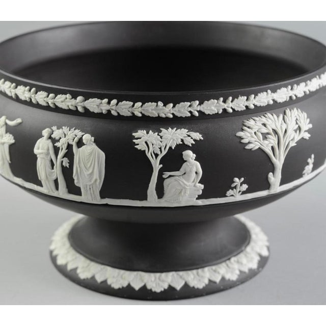 """Wedgwood Black Jasperware Footed Bowl With classical scenes and Oak & Acorn band, marked to underside. H: approx. 5"""". Rim..."""