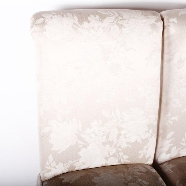 A pair of floral, off-white against pearl, tone on tone, fully upholstered wood framed Parsons chairs. These chairs...