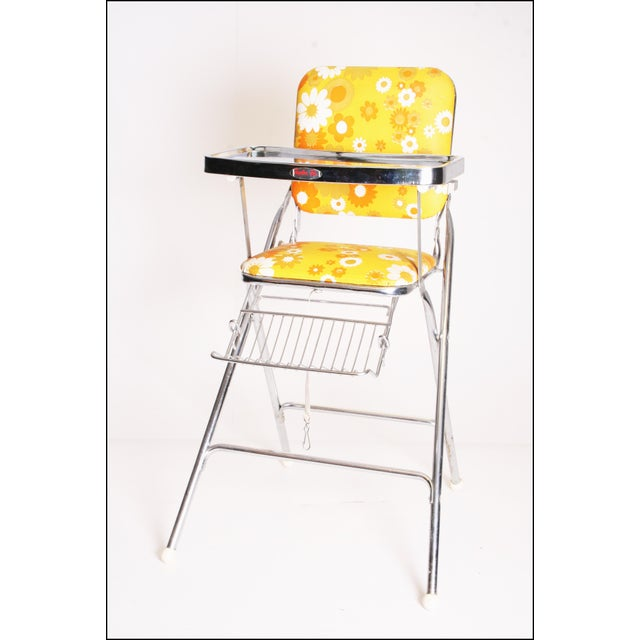 VINTAGE 1970s HIGH CHAIR. Nice yellow flower power print vinyl. Well made steel construction. The vinyl is in excellent...