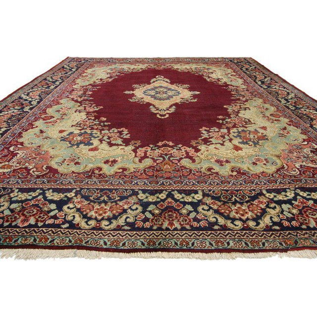 Vintage Persian Mahal rug with traditional style. This hand-knotted wool piece features an intricate lobed medallion...