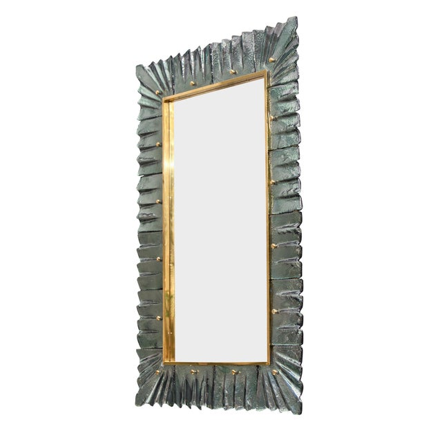 Murano glass aqua mirrors from Venice, Italy featuring hand-blown glass components framing a solid brass rectangular...