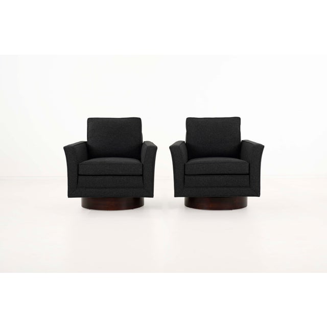 Pair of Swivel Lounge Chairs with ottoman, upholstered with new foam in Maharam Divina melange fabric. Lounge chairs...