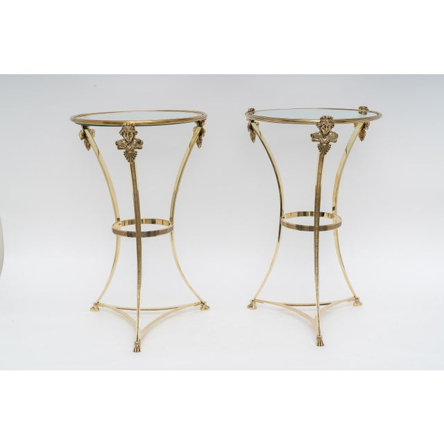 This stylish set of Maison Jansen, French Regence style brass side tables were acquired from a Palm Beach estate and date...
