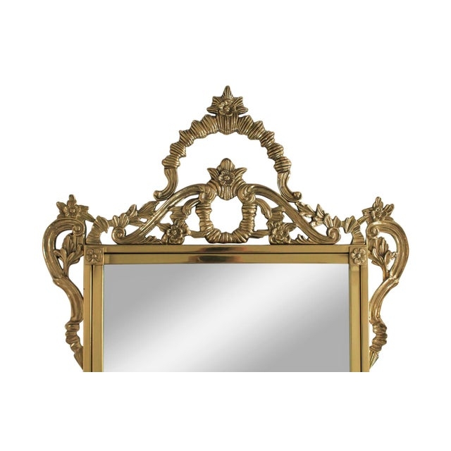 """Beautiful Hollywood regency style brass wall mirror with beveled mirror. Marked """"Made in Taiwan Republic of China"""". Small..."""