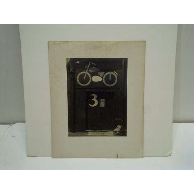 """This is a Vintage -- Black And White Photograph -- Mounted On Board -- Titled """"Motorcycle Door"""" -- Circa 1950."""